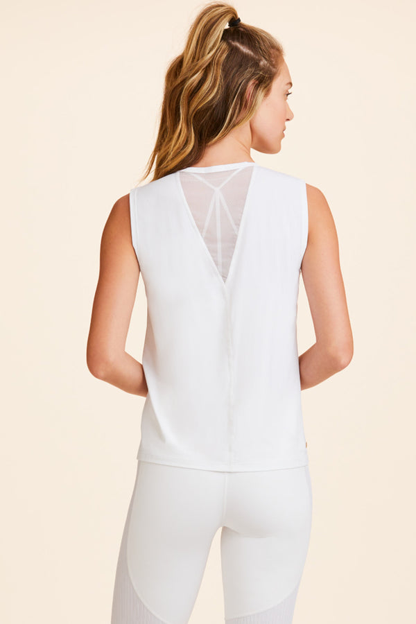 Front view of Alala Women's Luxury Athleisure white tank