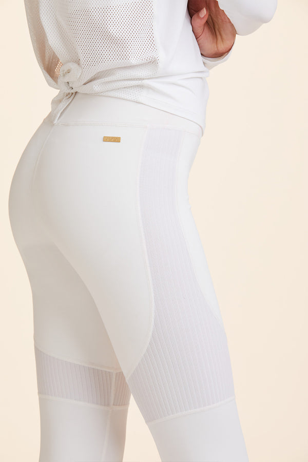 Front view of Alala Women's Luxury Athleisure white tight with rib detail
