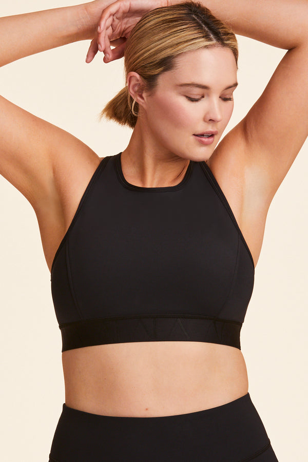 Front view of Alala Women's Luxury Athleisure black racerback bra in plus size