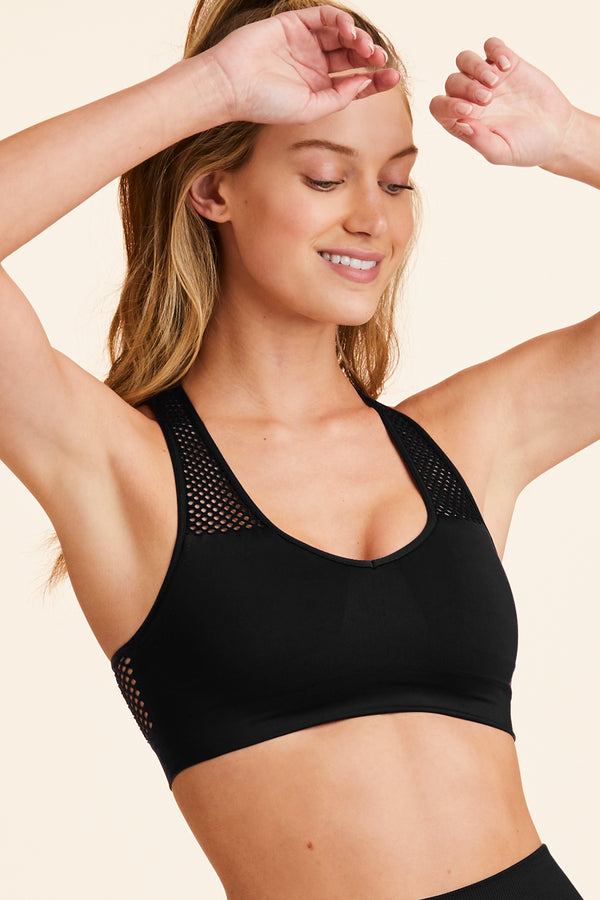 Front view of Alala Women's Luxury Athleisure black seamless bra