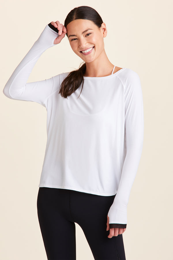 Front view of Alala Women's Luxury Athleisure white long sleeve tee