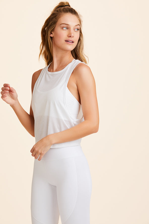 Front view of Alala Women's Luxury Athleisure white tie back mesh tank