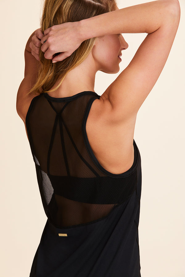 Front view of Alala Women's Luxury Athleisure black  tank with black mesh detail