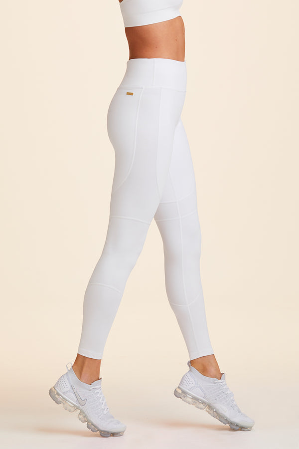 Side view of Alala Women's Luxury Athleisure white tight
