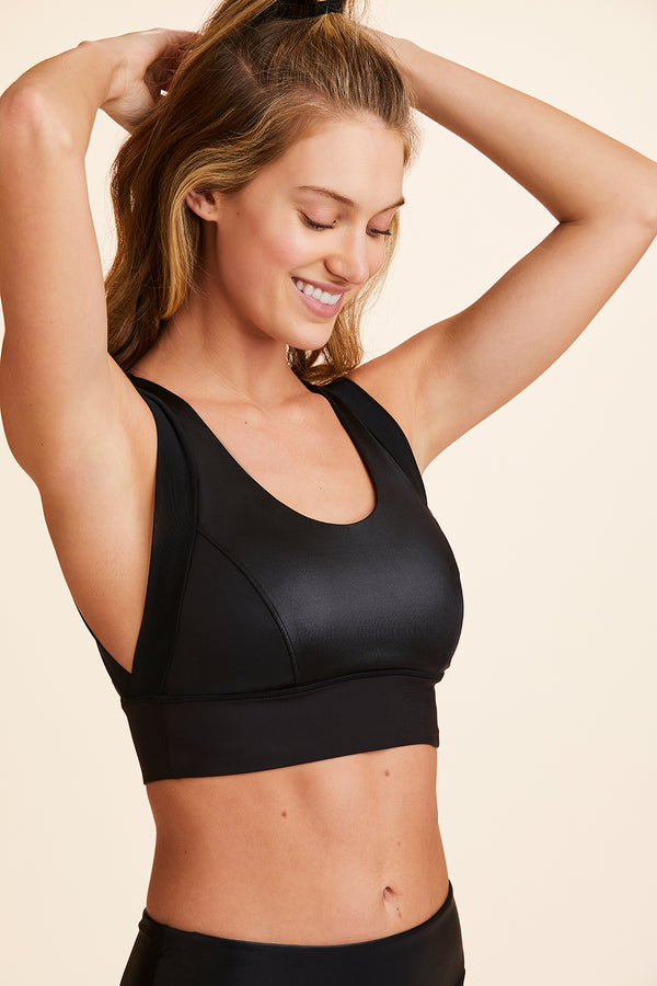 3/4 back view of Alala Women's Luxury Athleisure shiny black sports bra with open back detail