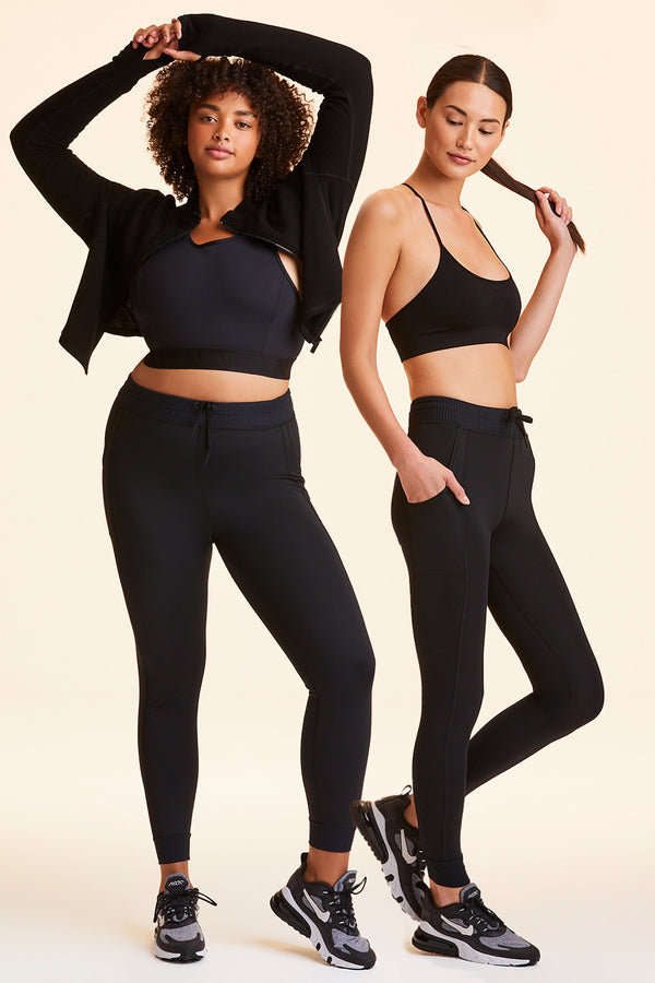 Front and side view of Alala Women's Luxury Athleisure black jogger-style tight