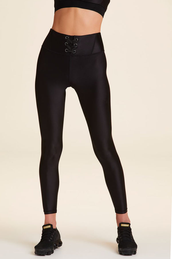 Front view of Alala Women's Luxury Athleisure black tight  with lace-up detail