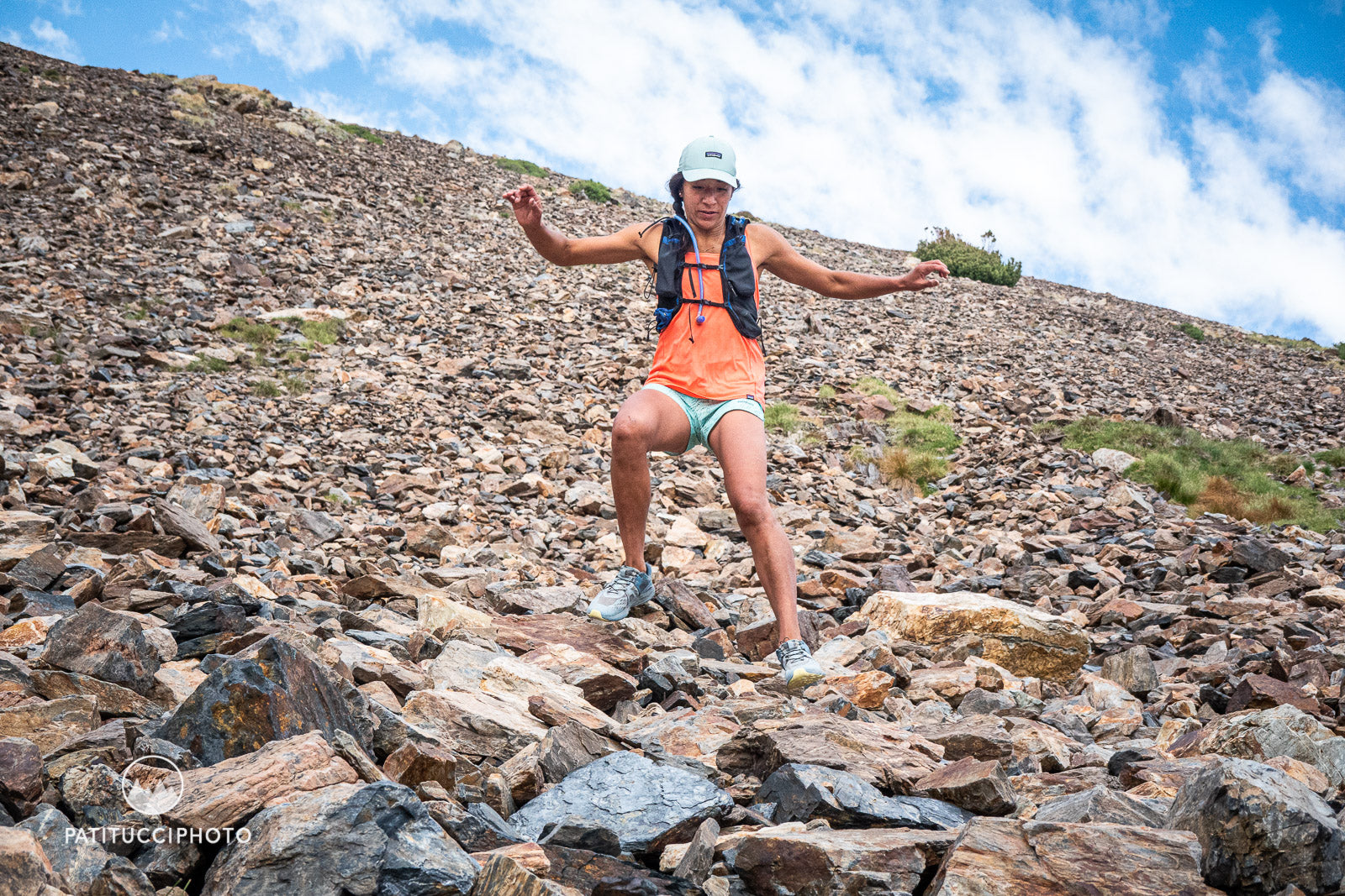 """Dani Reyes-Acosta scambles downhill on slate mountainside, in a type of running also known as """"scree skiing."""""""