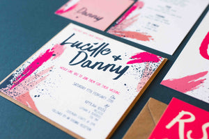 Bold colour pink paint splatter square wedding invitation with Kraft envelope.