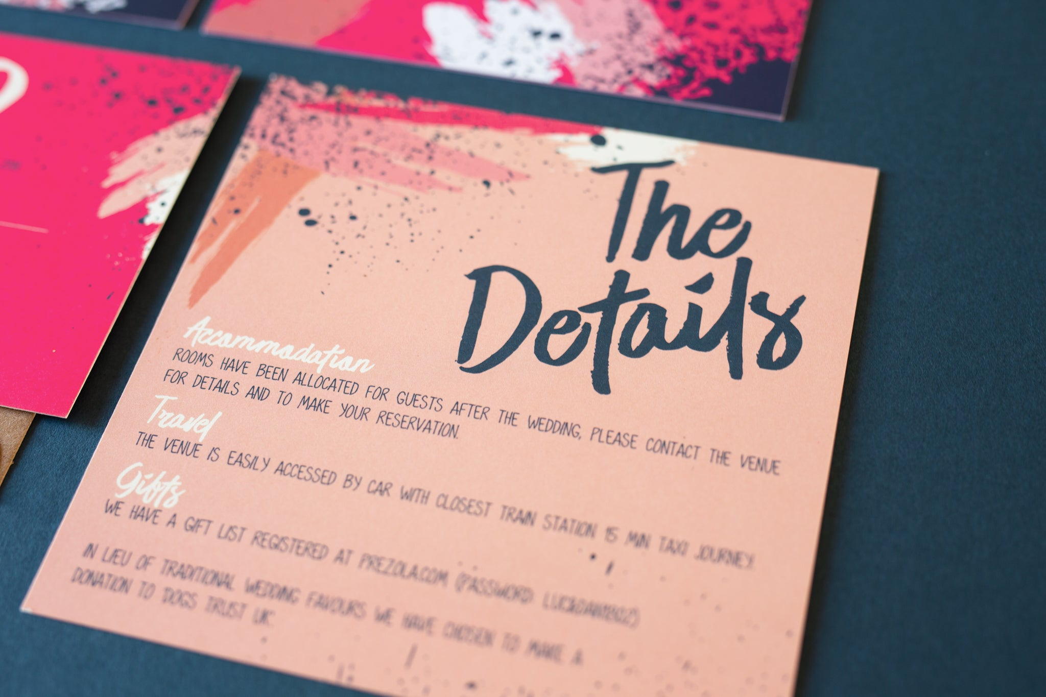 Peach pink wedding details card with pink splatter contemporary design.