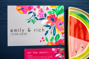 Bold colourful abstract flowers wedding invite on navy background.
