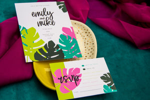 Wedding invitation with colourful leaf pattern to edge on pink and green background.