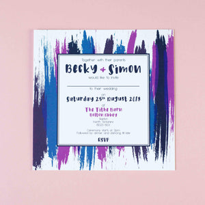 Square wedding invitation with navy, blue and purple contemporary paint splat design and a bold font.