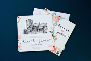 Hand drawn church sketch on save the date with flowery wedding invitation below on dark blue background.