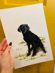 Watercolour painting of a black Labrador dog on an A4 sheet held up by a hand against a mustard yellow background.