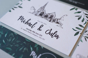Save the Date with black and white wedding venue drawing and green painted florals to the edge.  Close up shot