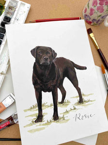 Painting of brown Labrador on brown background with painting and drawing supplies around the edge.