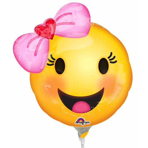 a small air filled foil balloon of emoji with bow that sits on a white plastic stick