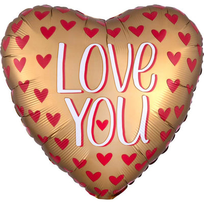 gold heart shaped balloon that says love you with multipe red hearts printed