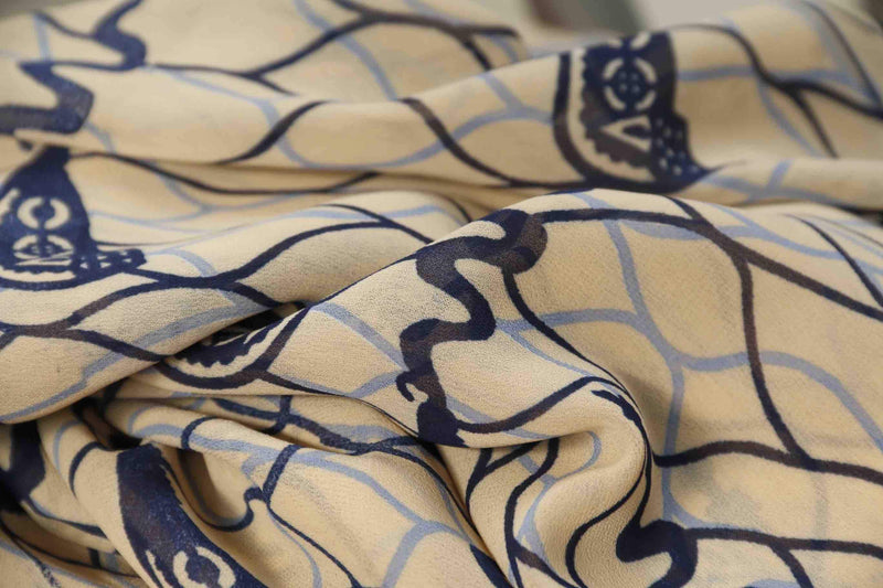 NAVY BLUE AND EGGSHELL CORKSCREW PRINT IN GEORGETTE