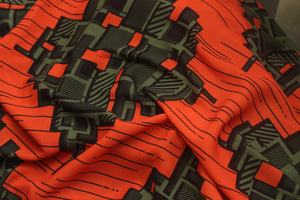 ORANGE BLOCK OF FLAT PRINT IN CREPE
