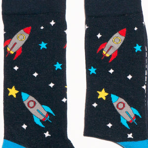 Socks that inspire us to remember those space exploration posters on our bedroom walls and and the days spent dreaming of blasting off to meet aliens from far off planets. Rocket-ships, stars, and, planets. Treat your feet to an out of this world experience.  Soft. Strong. Comfortable. Sustainable. Available in US Men's 4-8 and 8-12