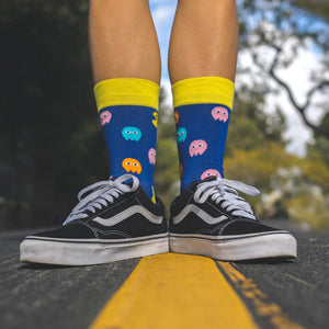 Who doesn't love the nostalgia of the 1980s retro, arcade games. What was your PacMan high score? Fun, comfortable socks that are a bold reminder of our misspent youth. An Incredible Socks collaboration with Andy Awesome, a Munich based 90's child who makes art out of the heroes of his childhood (and ours!).  Soft. Strong. Comfortable. Sustainable. Shown here in the middle of a quiet street on a pair of feet.  Available in US Men's 4-8 and 8-12. Incredible Socks. Pac Man
