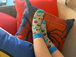 Kids socks with colorful superheroes on child's feet. Spider Man, Captain America, Iron Man, The Hulk. Made from sustainable bamboo.