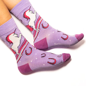 Unicorns, rainbows, horseshoes and fantastical attitude. Perfect shades of pink and purple muddled together make these socks must haves. Soft. Strong. Sustainable. Comfortable.   Available in US Men's 4-8