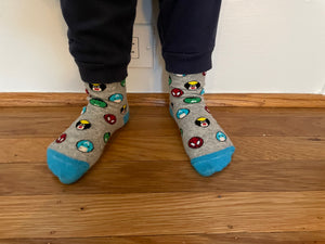 Kids socks on child's feet with colorful superheroes. Spider Man, Captain America, Iron Man, The Hulk. Made from sustainable bamboo.
