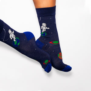 Socks that inspire us to remember those space exploration posters on our bed room walls and days spent dreaming of blasting off to meet aliens from far off planets. Space explorers, planets and tons of adventure awaits.  Soft. Strong. Comfortable. Sustainable. Available in US Men's 4-8 and 8-12
