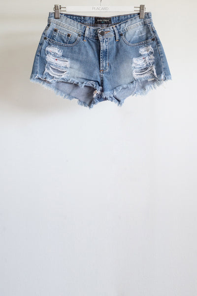SHORT RASGADO DENIM CELESTE