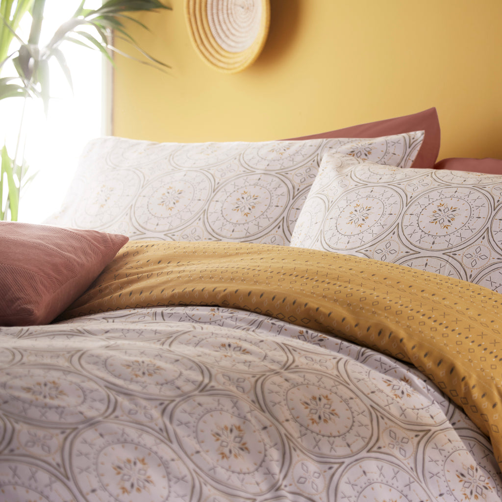 Mandala reversible duvet cover set, tribal design in white and ochre. Available in Single, Double, King and Super King sizes.