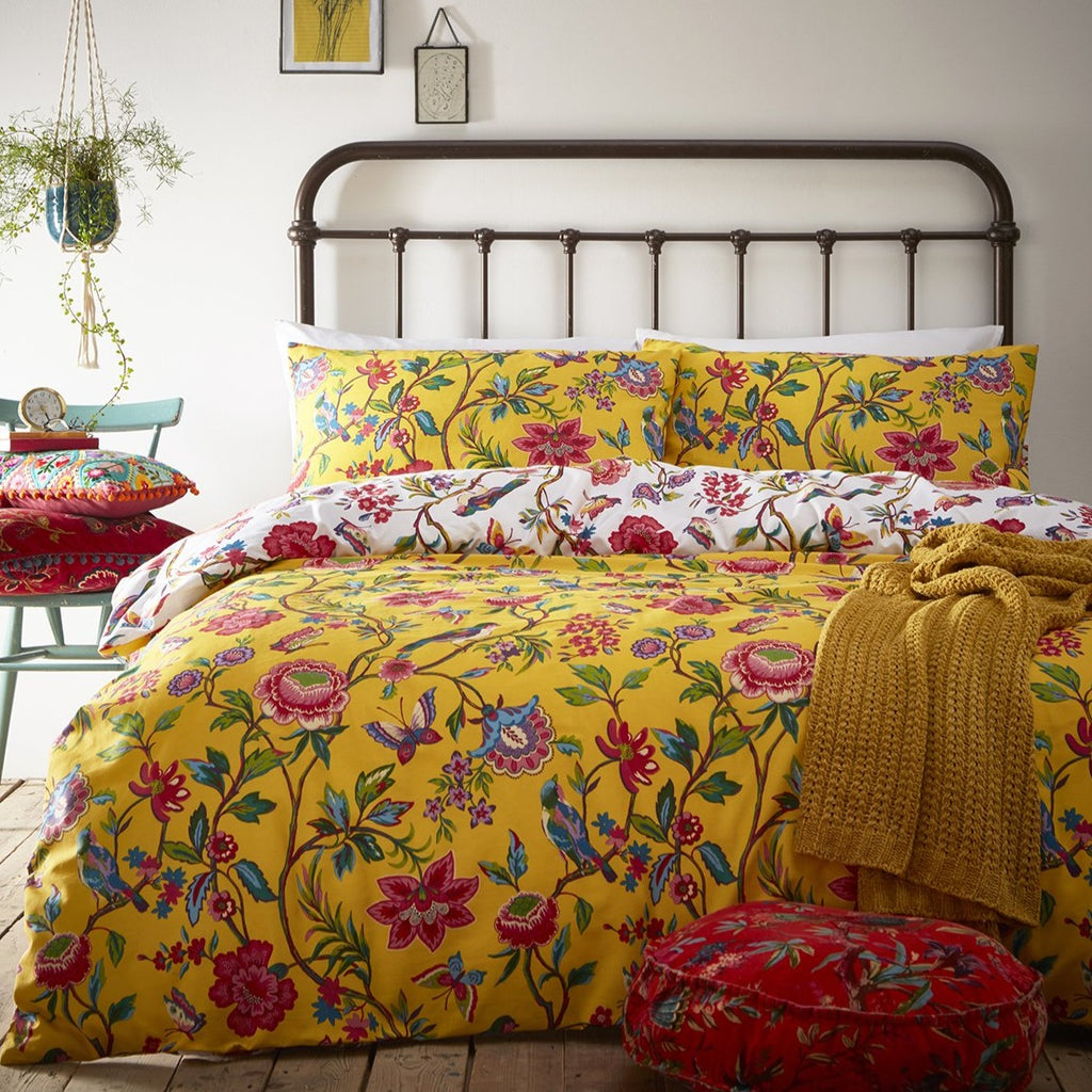 Pomelo duvet cover set in ochre, featuring exotic flowers, birds and butterflies, reversible design, available in single, double, king and super king sizes.