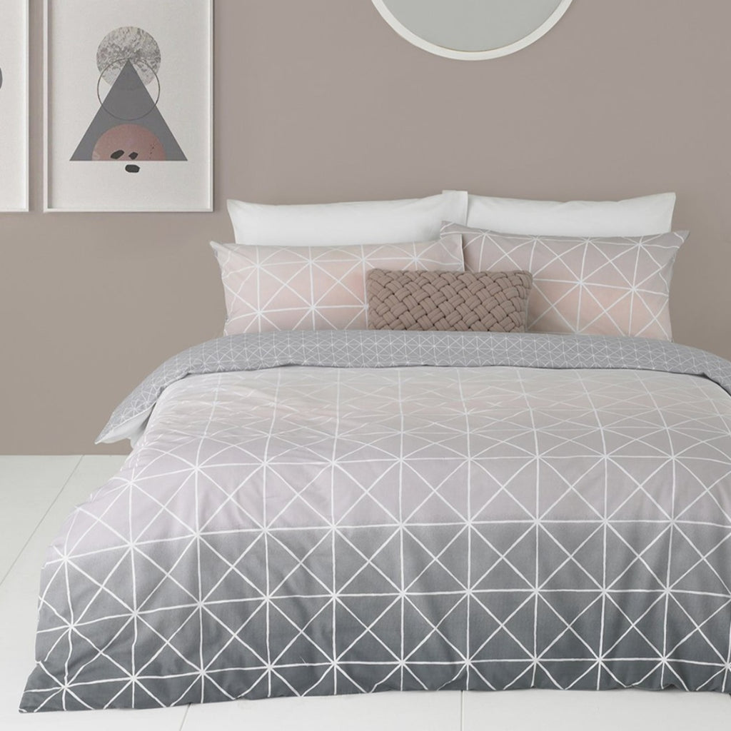 Spectrum duvet cover set in grey-blush, with geometric ombre design, available in single, double, king and super king sizes.