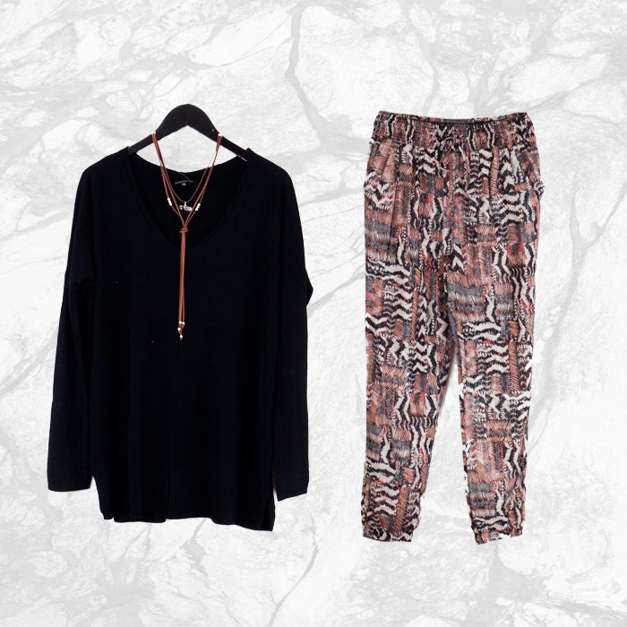comfy big black sweater, suede necklace, loose printed pants