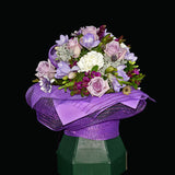 Enjoy this group of mauve roses, freesias and carnations in a self-contained Eco-box. Teresa Brough Designer Florist, Takaka NZ