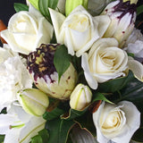 bouquet of white orientals, green chrysanthemums,and white roses
