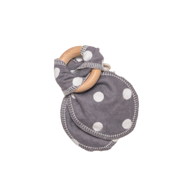 White polka dots on grey cotton teething ears that are attached to a maple wood ring.