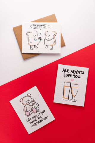 Three love-themed greeting cards laid out on a half red half white surface.
