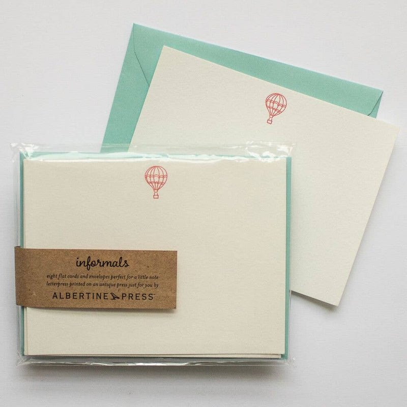 Hot air balloon blank greeting card with mint envelope. Each set of eight letterpress cards and envelopes comes packaged in a biodegradable cello sleeve.