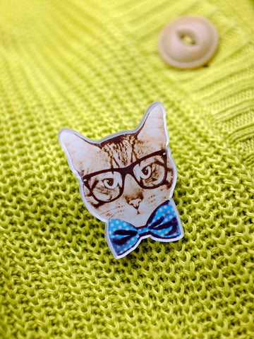 geek cat acrylic brooch - black specs and blue polka dot bow tie