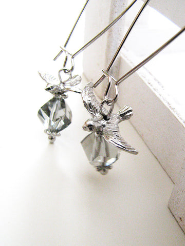 flying over snowy fields earrings