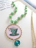 alice's tea cup necklace
