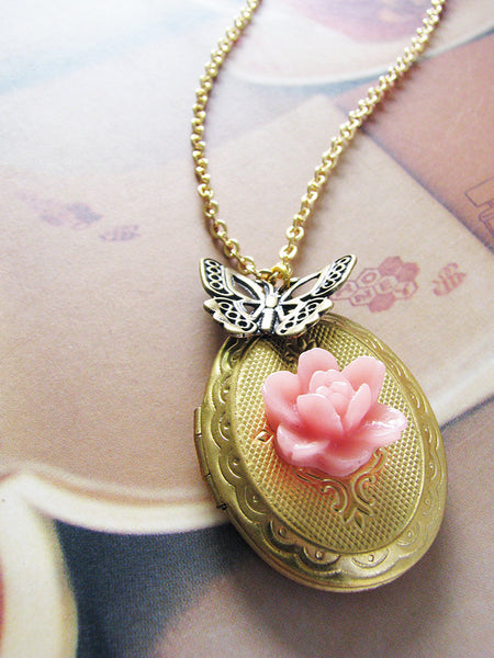 gold oval locket with pink rose and butterfly