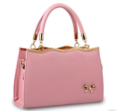Vintage style Bow handbag in pink faux leather