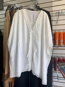 White Poncho lace-up front with crochet, tassel and pouff ball trims