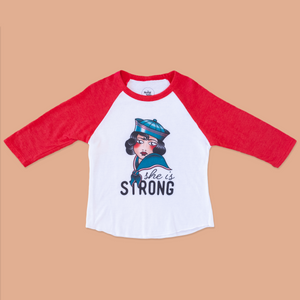The product photo of the the she is strong red raglan tee
