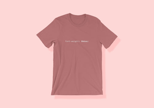 Dusty rose tee that reads 'font-weight: thicc;' in a console font