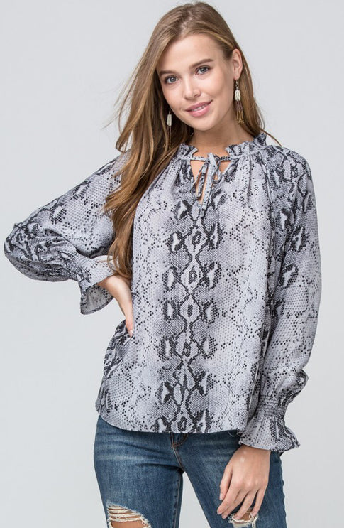 Reptile print peasant top featuring gathered self-tie closure detail at neckline
